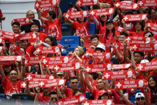 fans_of_roger_federer_of_switzerland_hold_up_signs_as_he_takes_part_in_an_exhibition_event_one_day_before_the_start_of_the_shanghai_masters_tennis_tournament_in_shanghai_on